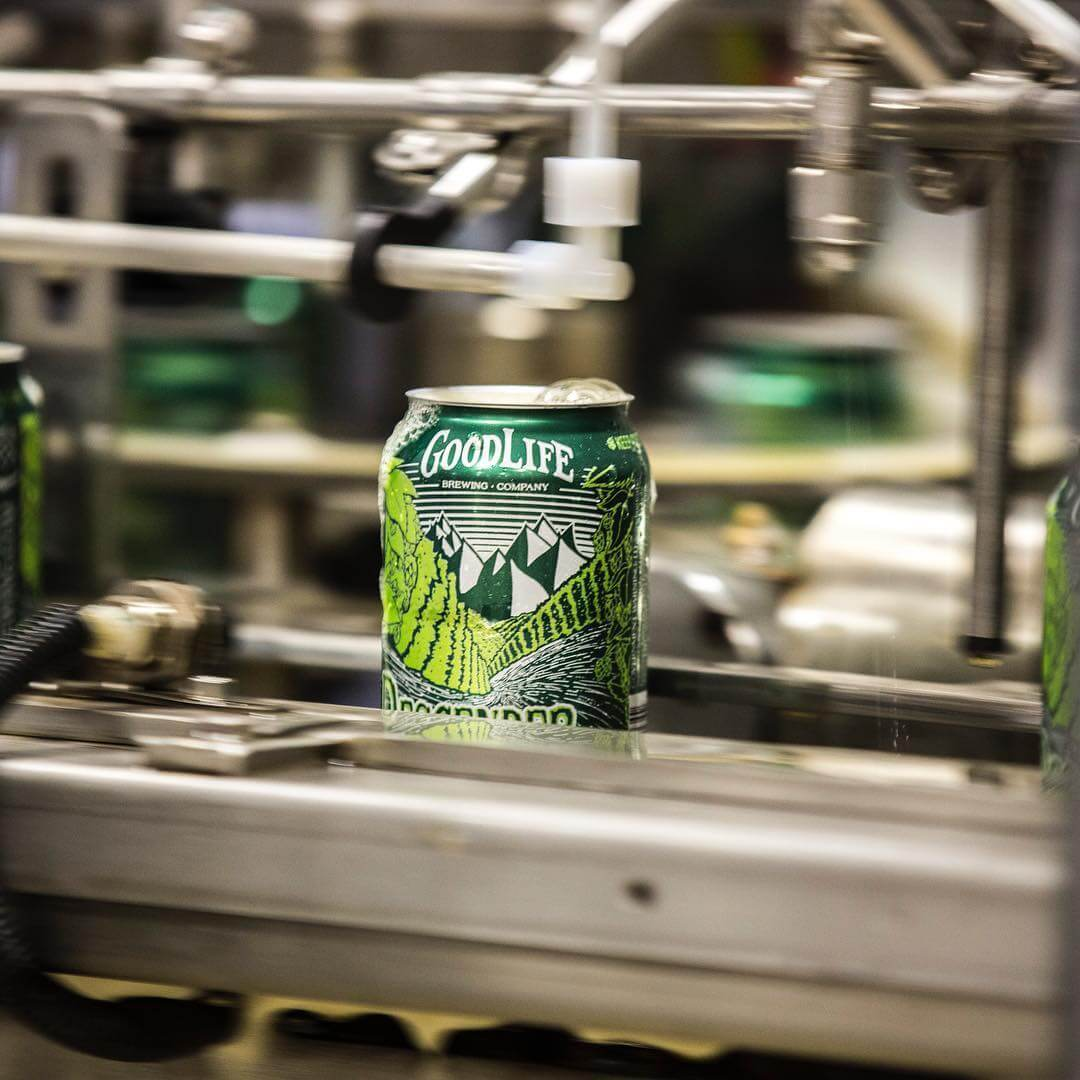 Fresh Descender IPA coming down the canning line for your next adventure or couch hang! 📸: @dangersoup