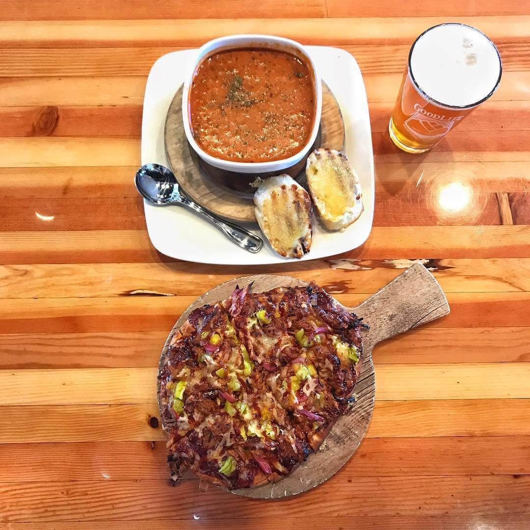 Today's lunch special in the pub is a BBQ Pork Flatbread with pepperoncini, pickled onions, and a habanero BBQ Sauce! Pair that with a delicious tomato soup with white cheddar crustini, and then wash it down with a Comatose Imperial IPA. That's what we call a solid Monday lunch!