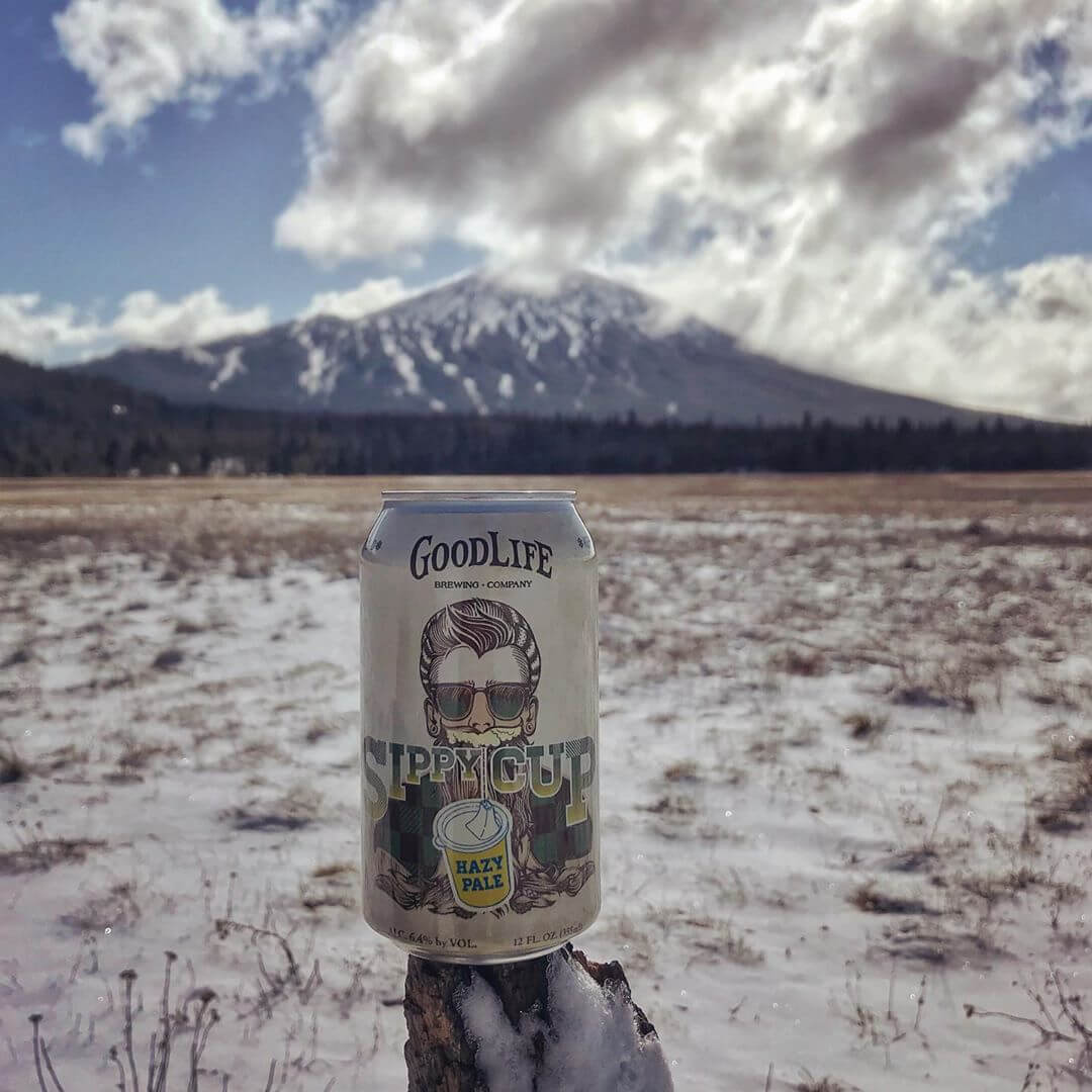 We've got a fresh new can and the mountain has a fresh new coat! #goodlifebrewing #sippycuphazypale