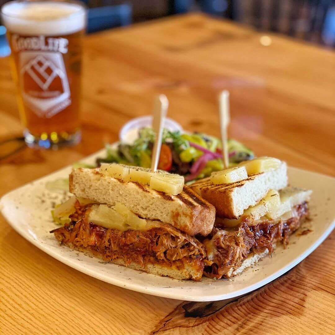 It's Locals Day and here is the food special for the day! It's a BBQ Pulled Pork Sandwich with pineapple, pickled red onions, havarti cheese and BBQ sauce! Pair that with a Mountain Rescue and that's what we call the GoodLife!